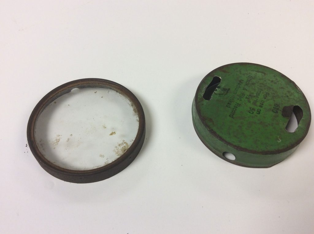 Holes drilled in tins for watch
