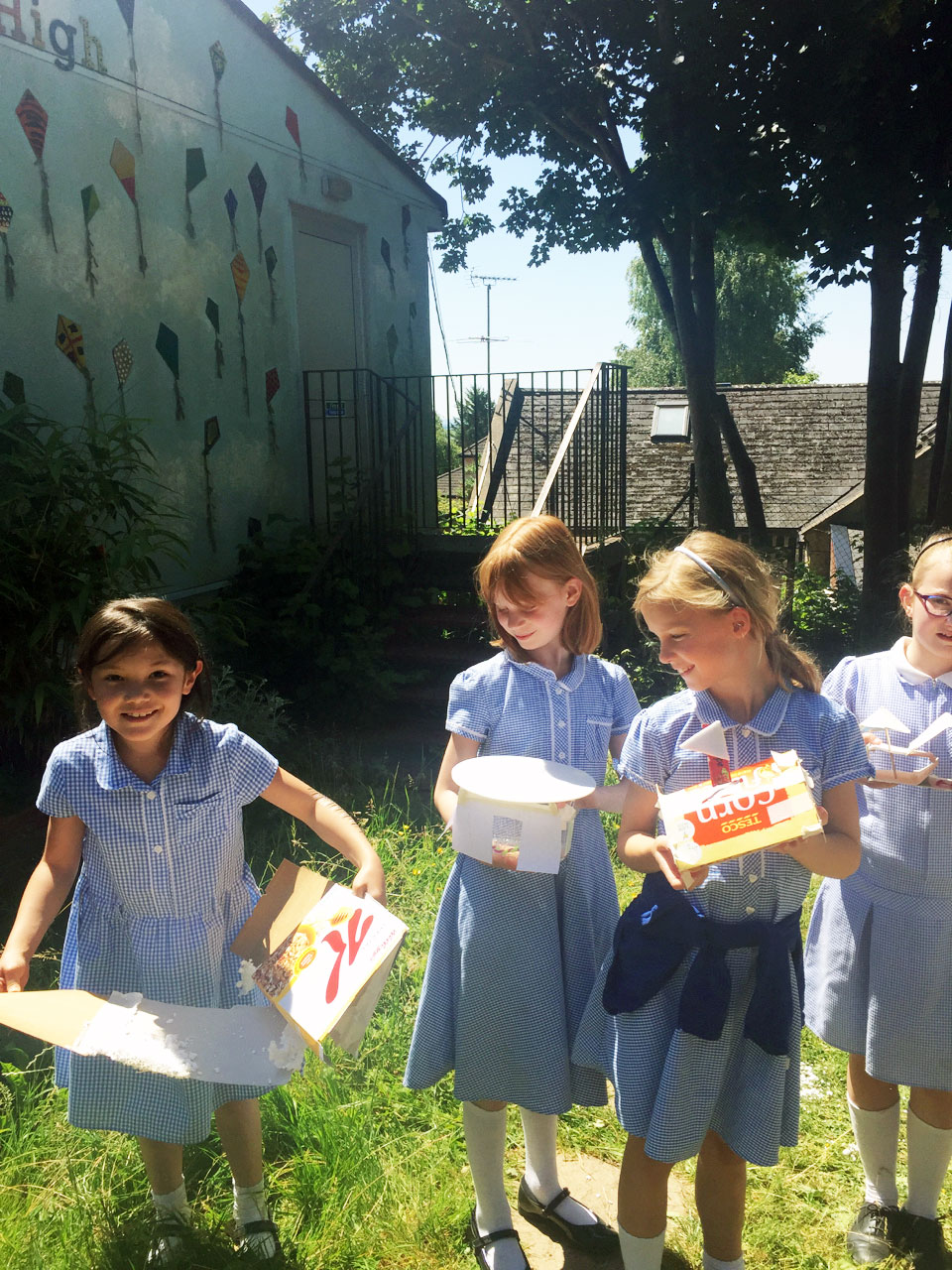 Girls displaying their UV shelters